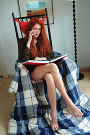 Studious redhead Adel C looks sexy in her gold rimmed glasses 01