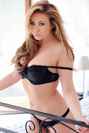 Leah Francis Teasing On The Bed In Black Lingerie